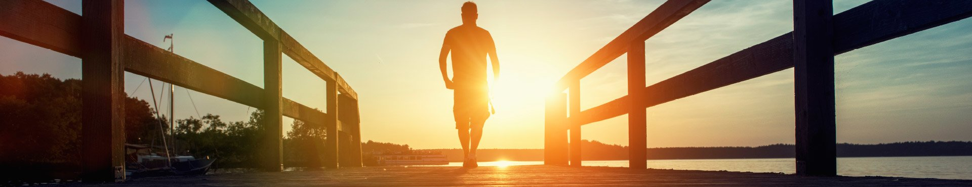 Man walking on a wharf | Shine Lawyers