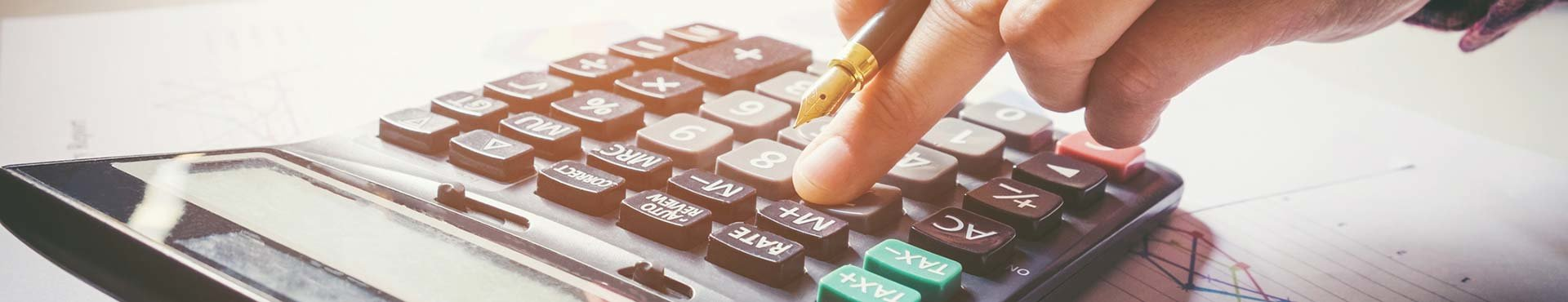 Man's hand calculating finance | Shine Lawyers