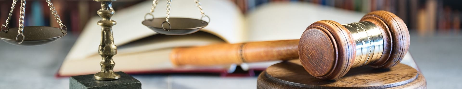 Gavel, scales and law books | Shine Lawyers