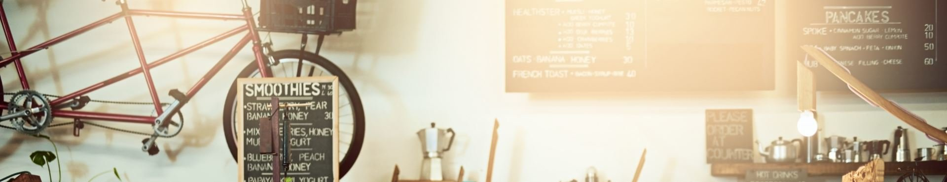 Woman behind a coffee counter | Shine Lawyers