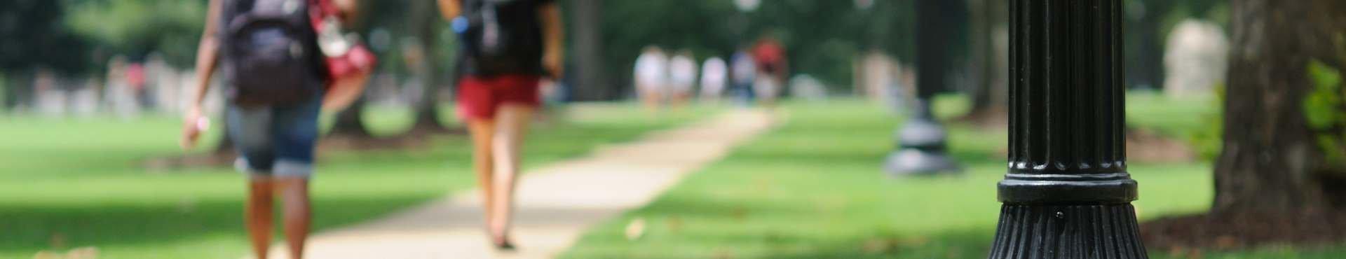 Students walking through campus | Shine Lawyers