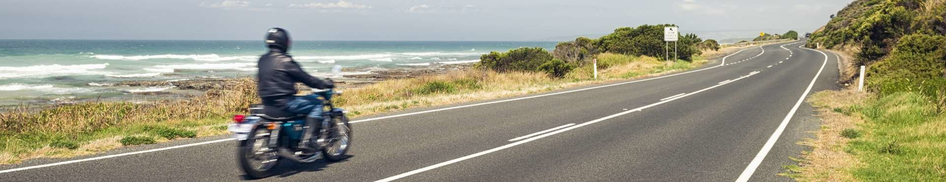 Motorcyclist on an open road | Shine Lawyers