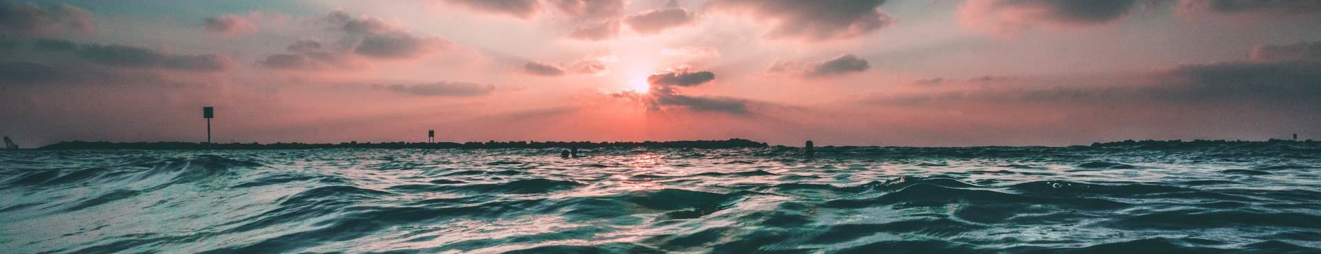 Sunset over the ocean | Shine Lawyers