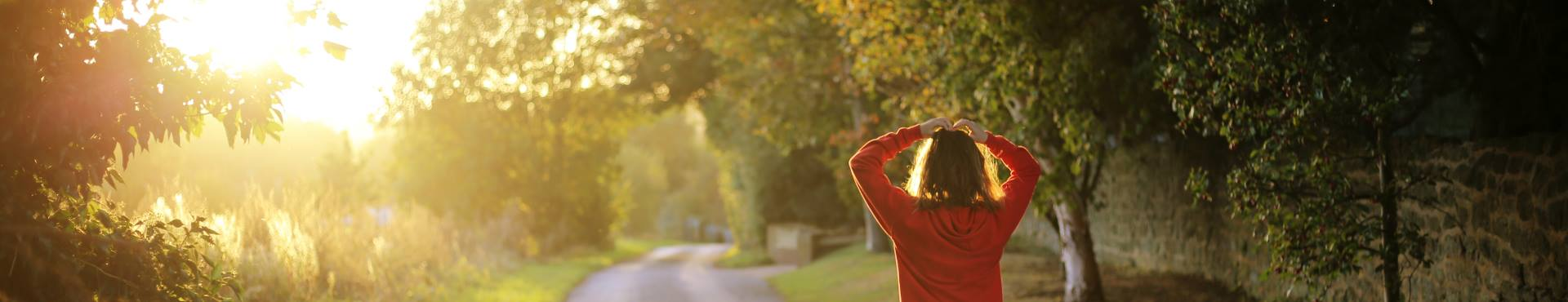 Woman jogging with the sunrise | Shine Lawyers