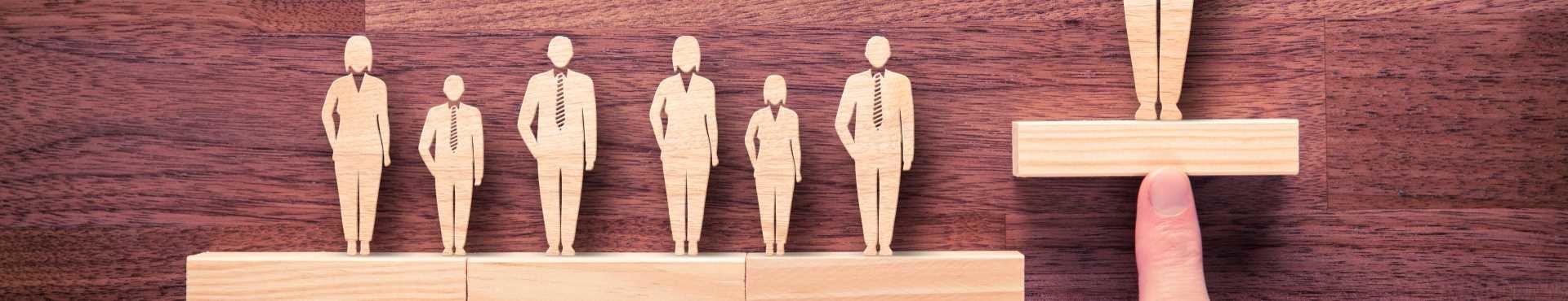 Wooden leadership figures | Shine Lawyers