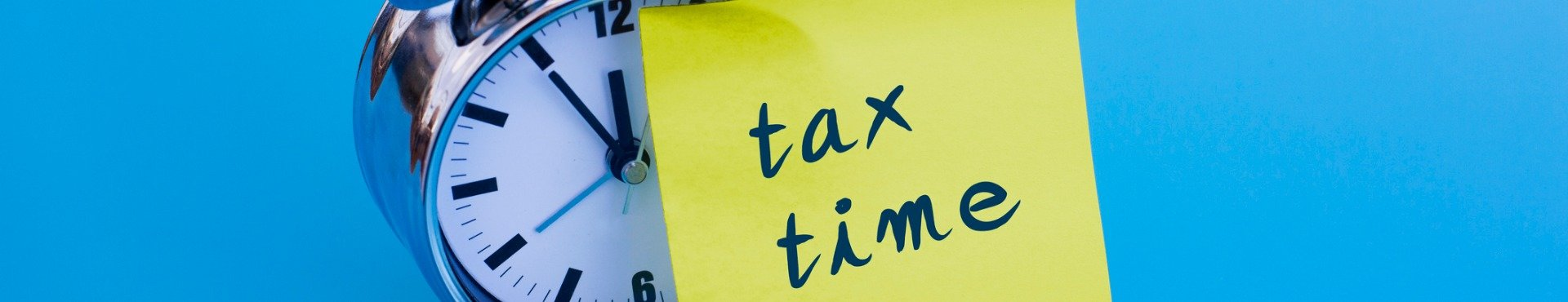 Alarm clock with note tax time | Shine Lawyers